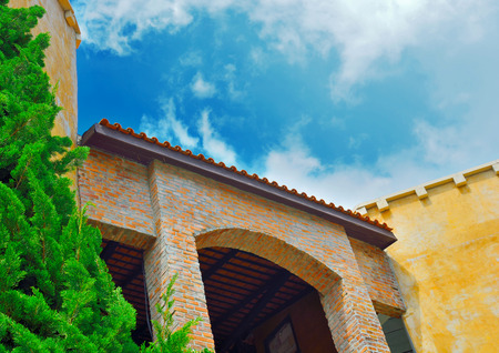 colorful italian entranc classic style on cloudy blue sky Standard-Bild