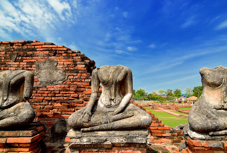 Old Buddha Statue at Chaiwattanaram temple in Ayutthaya Historical Park, central Thailand