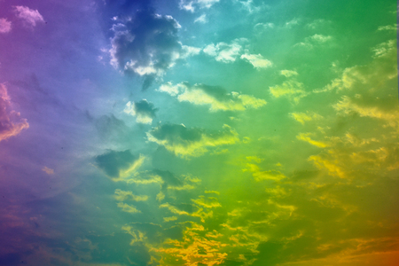 sky with floating clouds rainbow color.