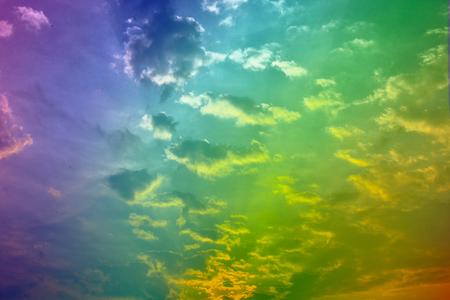 rainbow sky: sky with floating clouds rainbow color.