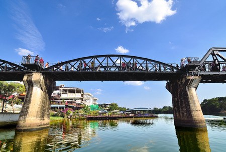 KANCHANABURI, THAILAND - FEBRUARY 23,2016: Tourists on the bridge over the river Kwai Khwae in Kanchanaburi