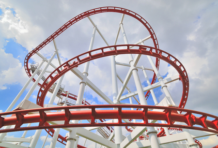 a steel roller coaster on cloudy
