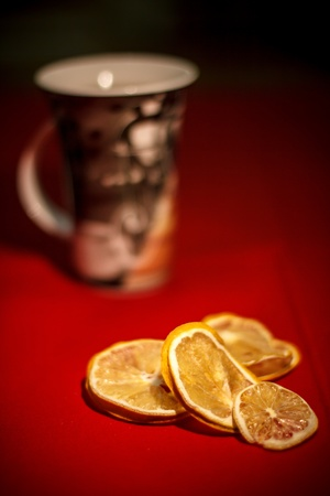 Close-Up shot of dried lemon with cup of tea Stock Photo