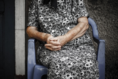 Senior s hands  Hands of an 82-year-old woman resting on lap Stock Photo