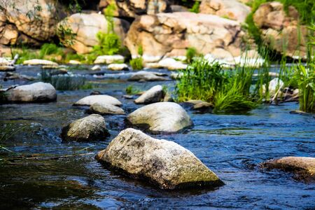 mountain river with mossy stones