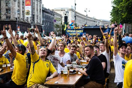 KIEV, UKRAINE - JUNE 10  Swedish fans have fun during UEFA Euro 2012 on June 10, 2012 in Kiev, Ukraine  Cheering fans celebrating goal Editorial