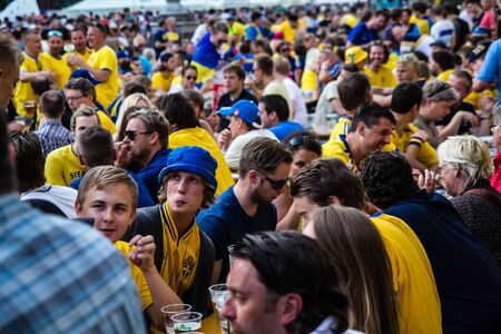 KIEV, UKRAINE - JUNE 10  Cheering Sweden and Ukrainian fans have fun in the fanzone  during UEFA Euro 2012 on June 10, 2012 in Kiev, Ukraine