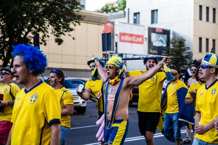 KIEV, UKRAINE - JUNE 11  Cheering Sweden fans go to stadium before match Euro 2012 on June 11, 2012 in Kiev, Ukraine