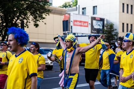 KIEV, UKRAINE - JUNE 11  Cheering Sweden fans go to stadium before match Euro 2012 on June 11, 2012 in Kiev, Ukraine  Stock Photo - 20527120