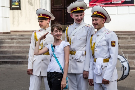 KYIV, UKRAINE - MAY 19  Three cadets with drums  flirt with girl in the