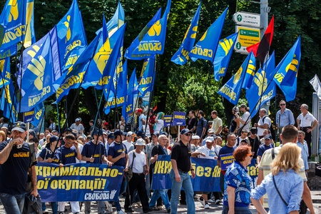Unidentified protestors of  Rise up, Ukraine   demonstration march in Kiev, Ukraine on May 18, 2013   Rise up, Ukraine   - a political protest by opposition parties against the regime of President of Ukraine Viktor Yanukovych  Editorial