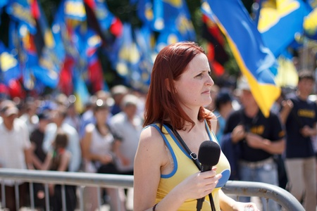Journalist making report with protestors of  Rise up, Ukraine   demonstration in Kiev, Ukraine on May 18, 2013   Rise up, Ukraine   - a political protest by opposition parties against the regime of President of Ukraine Viktor Yanukovych  Editorial
