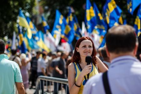 Journalist making report with protestors of  Rise up, Ukraine   demonstration in Kiev, Ukraine on May 18, 2013   Rise up, Ukraine   - a political protest by opposition parties against the regime of President of Ukraine Viktor Yanukovych  Editorial