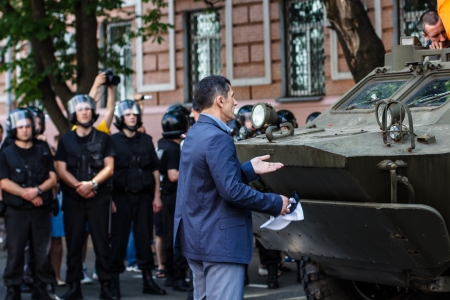 Unidentified protestor trys to stop provocation - moving of  armored military vehicle in   Rise up, Ukraine   demonstration in Kiev, Ukraine on May 18, 2013   Rise up, Ukraine   - a political protest by opposition parties against the regime of President o