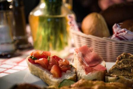 Breakfast with juice, omelette, sandwich, jamon and salmon. Breakfast table arrangement