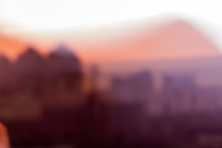 blurred view of Kiev city at sunset. view through binoculars