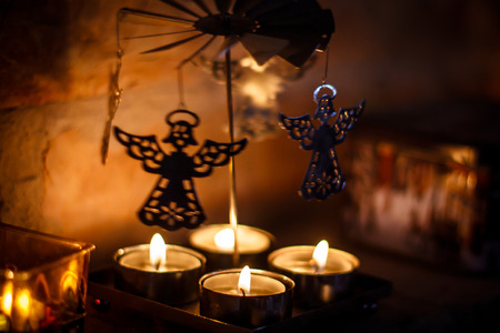 Lit candles and dancing angels