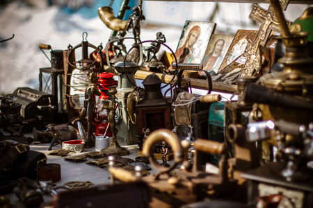 Old fashioned  antique decorative items on the Kievs flea market, winter. Stock Photo