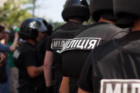 group of ukrainian riot policemen wearing protective vest and helmet.