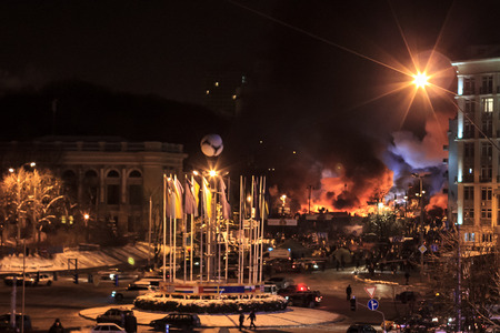 KIEV  KYIV , UKRAINE - JANUARY 26, 2014  Anti-goverment protests in Kiev, Ukraine  Protesters defend barricades and burn tires on Hrushevskoho Street
