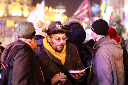 KIEV  KYIV , UKRAINE - DECEMBER 4, 2013  Euromaidan protesters rest  Unidentified people taking part in anti-goverment protests in Kiev, Ukraine