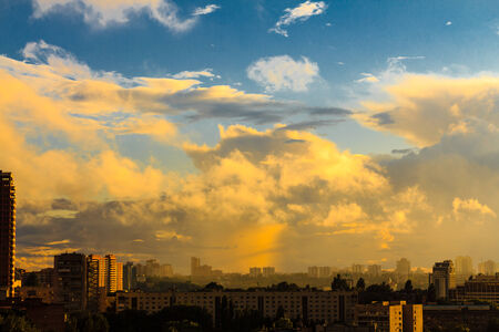Kiev with dramatic cloud cover, gh  Beautiful colors phenomenon in dark blue sky, overcast weather