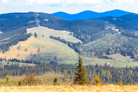 Scenic mountain landscape shot near Hoverla. Carpathian, Ukraine, Europe.  Mountain ridges panorama. Dramatic sky.