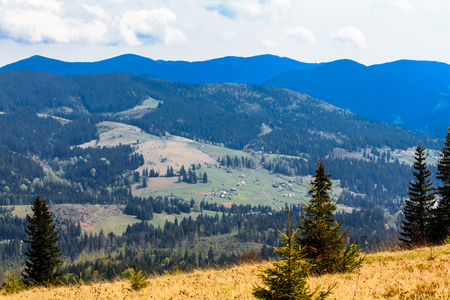 Scenic mountain landscape shot near Hoverla. Carpathian, Ukraine, Europe.  Mountain ridges panorama. Dramatic sky.
