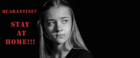 Close-up of a black-and-white portrait of a serious, thoughtful young girl on a black isolated background, red lettering. The concept of quarantine, stay at home. Banner, text space