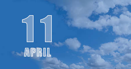April 11.11-th day of the month, calendar date.White numbers against a blue sky with clouds. Copy space, Spring month, day of the year concept.