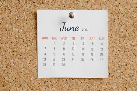 Page from the calendar for the full month: June 2021. White calendar sheet attached to brown cork board