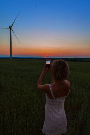 The girl taking a photo of the windmill