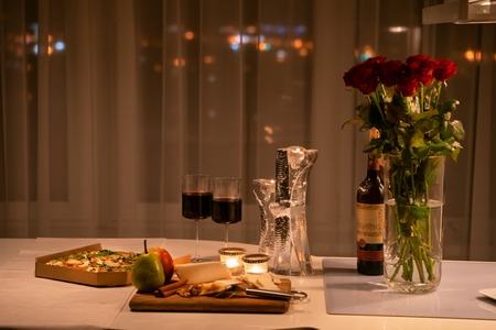 romantic dinner setup with candle light ay home. Selective focus. Vintage color. Reklamní fotografie