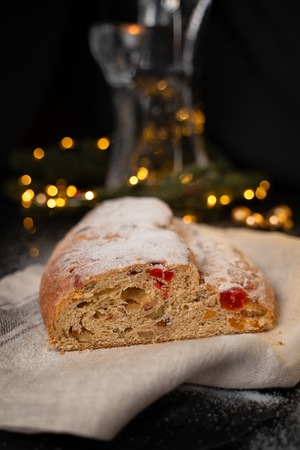 Traditional European Christmas pastry, fragrant home baked stollen, with spices and dried fruit.