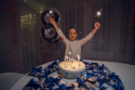 Parents congratulate the 8 years Boy with birthday Imagens