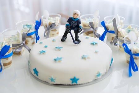 Cake with mastic Ice Hockey Player figure