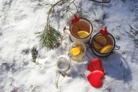 Nice warm cup of tea or coffee outdoors in the snowy scene Stock Photo