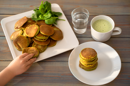 Dietary pancakes with spinach. Stack of pancakes