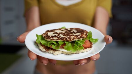 Keto Diet Bread Sandwich in female hands. Imagens