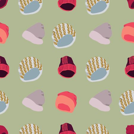 Winter headwear Illustration of knitted beanies seamless pattern on green background. Web, wrapping paper, textile, wallpaper design, background fill.
