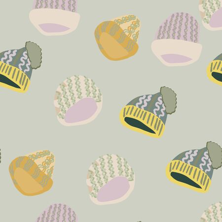 Trendy winter headwear knitted beanies seamless pattern on light green background. Web, wrapping paper, textile, wallpaper design, background fill. Vettoriali
