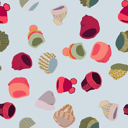 Winter headwear. Illustration of knitted hats and beanies in seamless pattern on blue background. Web, wrapping paper, textile, wallpaper design, background fill.
