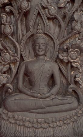 wooden buddha in thailand photo