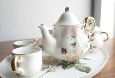 White porcelain set for tea on the table