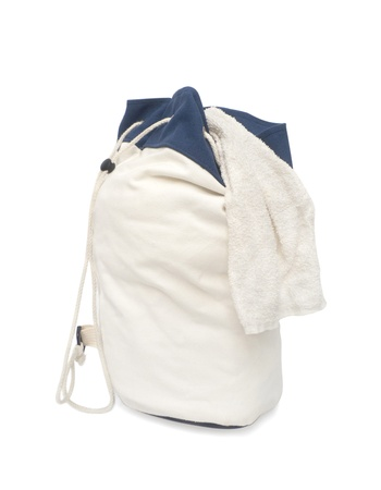 White Laundry Bag with towel Piled on Top.