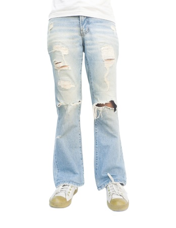 Young woman wearing torn jeans.
