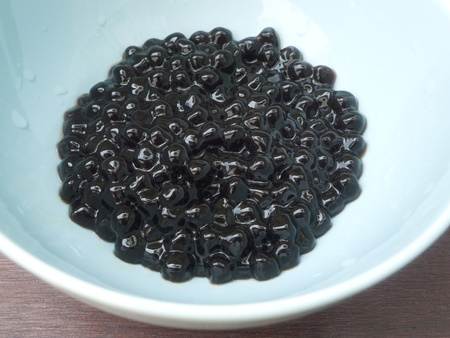 Boiled Tapioca Pearls on blue cup.For Bubble tea concepts.  Stock Photo