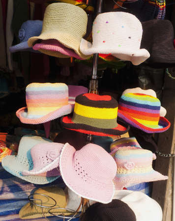 Colorful woven hat hanging on shop.