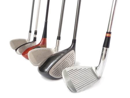 Three diferent golf clubs on white background.