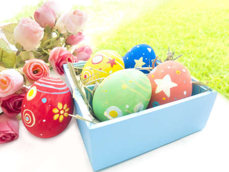 Easter eggs and roses on the white background   Stock Photo